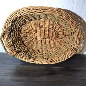 Old light colored basket with rattan handles